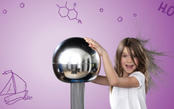 Girl having fun learning about static electricity