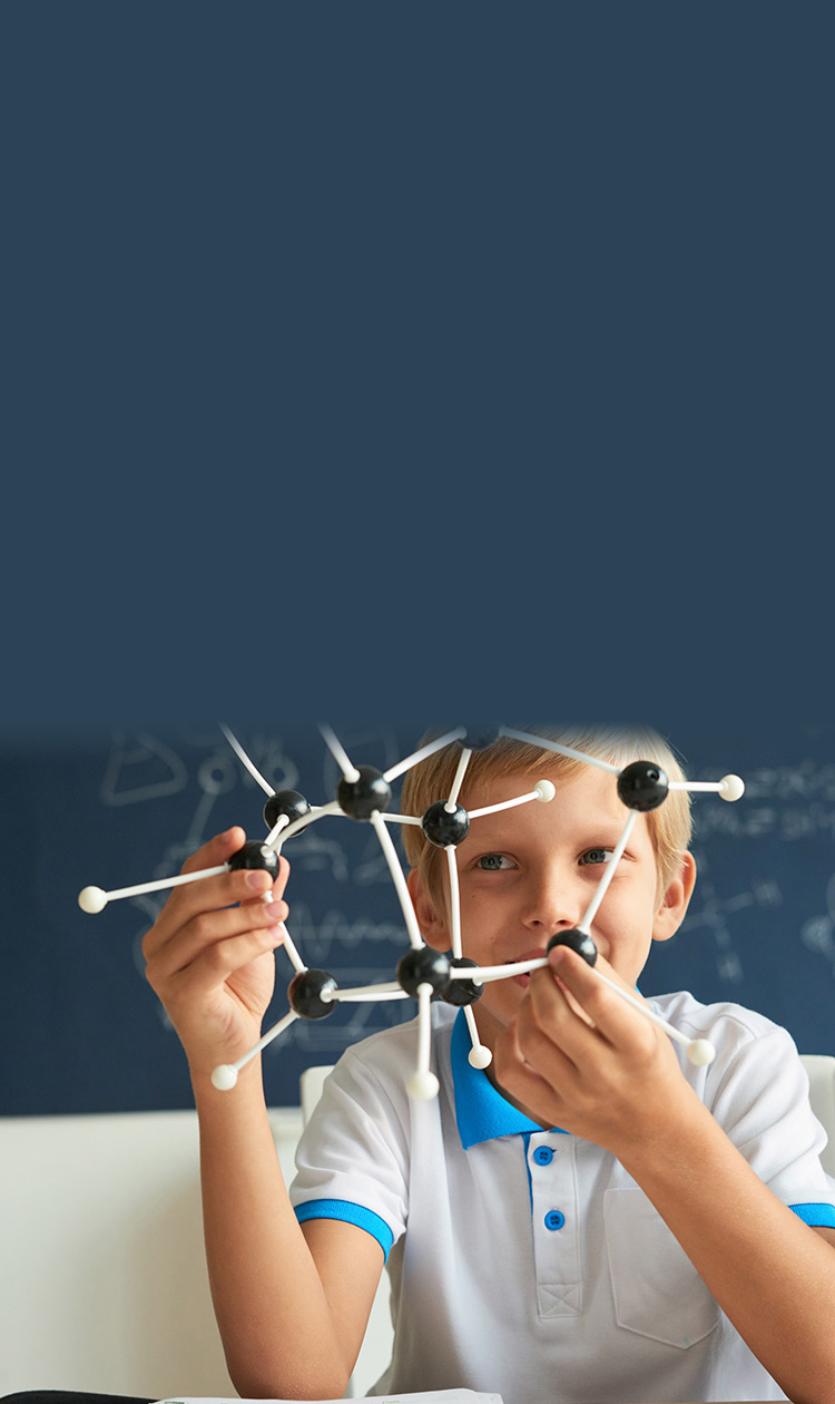 boy learning about molecules in an after school program